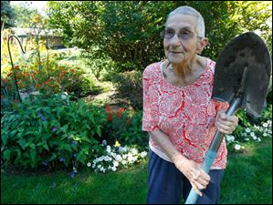Marie F. McCarty loves to dig in the dirt and has planted a flower garden wherever she has lived.