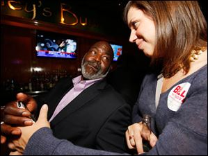 Mayor Mike Bell and Jen Sorgenfrei keep up on election news.