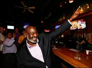 Mayor Mike Bell celebrates winning the primary election Tuesday.