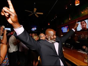 Mayor Mike Bell celebrates winning the primary election.