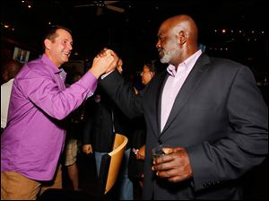 Mayor Mike Bell is greeted by Steve Cady at an election night party.