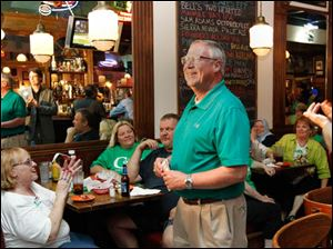 Michael Collins is all smiles as he takes the lead in early primary election results at Doc Watson's in Toledo, Ohio.