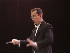 Jason Stumbo will conduct the University of Toledo Symphony Orchestra and Wind Ensemble and the university choral group Da Capo in UT's Doermann Theater at 3 p.m. Sept. 22.