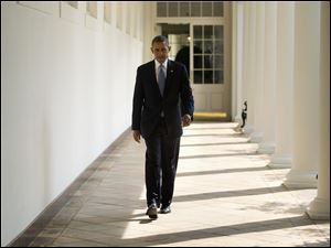President Obama walks along the West Wing Colonnade toward the Oval Office of the White House in Washington today ahead of his daily briefing. Obama will deliver a speech on Syria from the East Room in an address to the nation this evening.