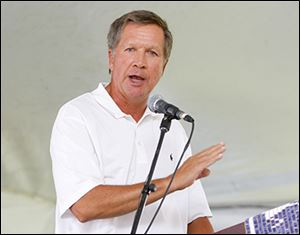 In his speech, Gov. John Kasich heralded the courage of those who fought and he paid tribute to the lives lost.