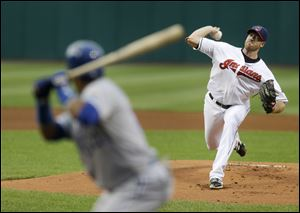 Cleveland Indians starting pitcher Zach McAllister, right, delivers to Kansas City Royals' Emilio Bonifacio, left, in the first inning.