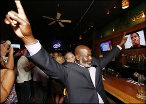 Mayor Bell notes his finish among the primary candidates during his election bash at Mulvaney's Bunker Irish Pub.