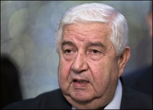 Syrian Foreign Minister Walid al-Moallem speaks to the media in Moscow, Monday. Syria's foreign minister said his country welcomes Russia's proposal for it to place its chemical weapons under international control and then dismantle them q