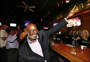 With supporters, Mayor Mike Bell celebrates his first-place showing.