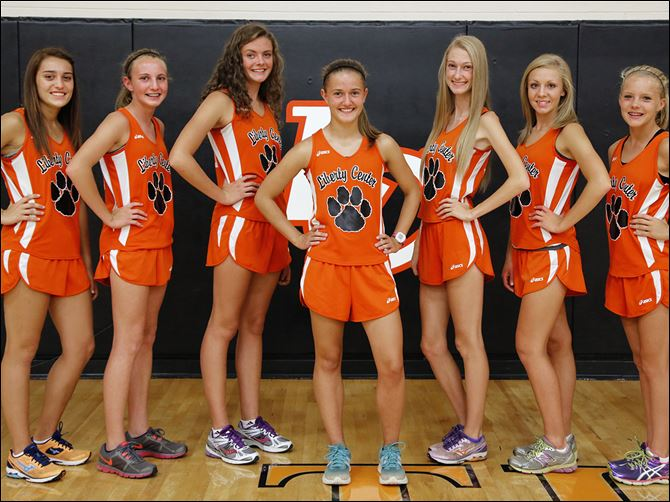12s5Liberty Liberty Center is looking to capture a third consecutive Division III state girls cross country championship with, from left, Emma Babcock, Cheryl Davenport,  Olivia Kundo, Brittany Atkinson, Paige Chamberlain, Sara Knapp, and Jenna Vollmar.