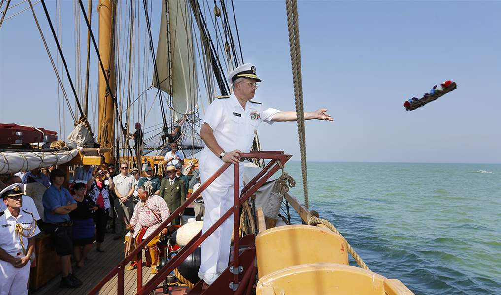 Rear-Admiral-Joseph-Horn-puts-a-wreath-in-Lake-Erie