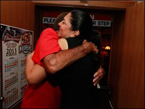 Anita Lopez hugs campaign worker John Sheets on election night at Michael's Bar & Grill on September 10, 2013.