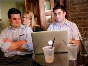 Joe McNamara watches as results come in with his wife, Valerie Moffitt, and campaign manager Andrew Grunwald.
