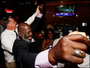 Mayor Mike Bell celebrates winning the primary election Tuesday, 09/10/13, at Mulvaney's Bunker Irish Pub.