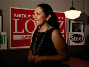 Anita Lopez speaks to the media on election night at Michael's Bar & Grill on September 10, 2013.
