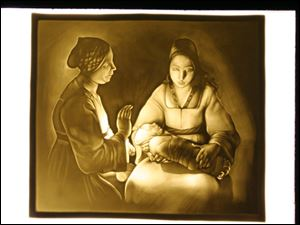 George De La Tour's 'The New Born' lithophane is one of the works in the collection of the Blair Museum of Lithophanes at Toledo Botanical Garden.