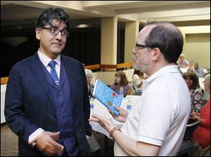 Author Sherman Alexie, left, meets fan Ken Adler prior to Mr. Alexie's speech as part of the the Authors! Authors! series at the Stranahan Theater.