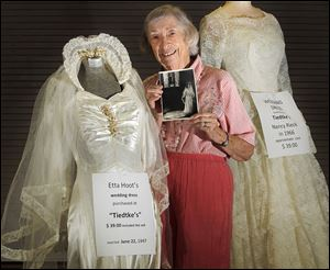 Etta Hoot shows the wedding dress and veil she bought at Tiedtke's for $39. It will be among the items on display Friday and Saturday.
