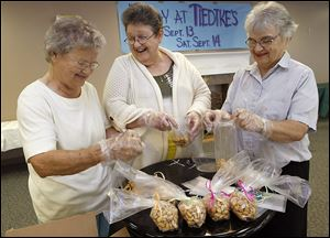 Evelyn Crossen, Sally Snell and Sally Shaw bag cashews for Tiedtke's Days at the Margaret Hunt Senior Center. Fresh cashews were just one of numerous Tiedtke's mainstays.