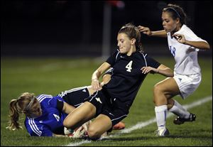 Anthony Wayne goalkeeper Taylor Hill stops the ball as Perrysburg's Lucy Walton, center, and the Generals' Baily Hertzfeld move in.