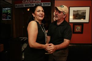 Anita Lopez shakes hands with Councilman Steven C. Steel on election night at Michael's Bar & Grill. Lopez did not show up until around midnight.