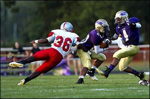 Bowsher junior Phoenix Reid tackles Maumee's Brian Autry. Reid is third on the team with 11 tackles.