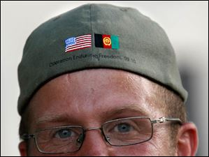 Veteran Brian Stark wears a ball cap from Operation Enduring Freedom at the end of his walk from Oak Harbor to Toledo.