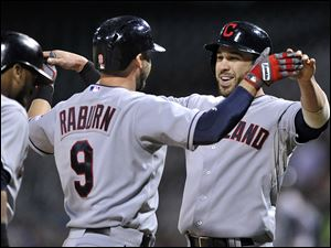 The Indians' Ryan Raburn celebrates with teammate Jason Kipnis, right, after hitting a three-run home run during the first inning against the Chicago White Sox.