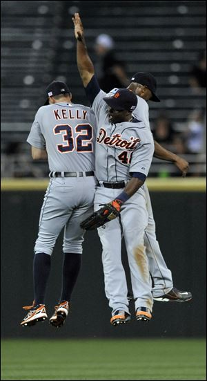 Detroit Tigers outfielders Don Kelly (32), Austin Jackson, and Torii Hunter (48) celebrate after defeating the Chicago White Sox 1-0.