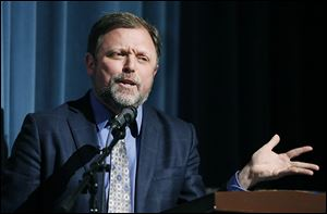 Anti-racist author, educator, and essayist Tim Wise speaks during the forum on racism Thursday at Woodward High School.  The event was sponsored by the Toledo Community Coalition and The Blade.
