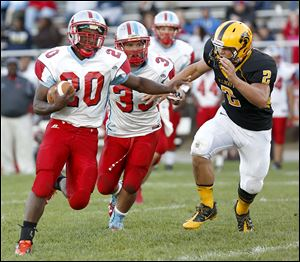 Bowsher's Kahne Collins dodges Northview's Jake Bilek. Collins gained 208 yards on xx carries and scored a touchdown.