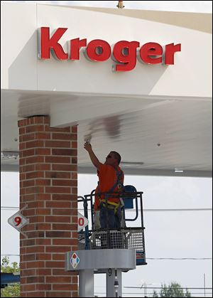Dale Ault of County Fire installs a fire suppression system at the gas station of the new Kroger on Conant Street at Dussel Road in Maumee. The 86,000-square-foot store is part of a resurgence of retail building that includes an Art Van store in Springfield Township that opened recently.