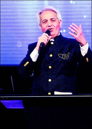 Benny Hinn speaks at Cornerstone Church in Maumee.