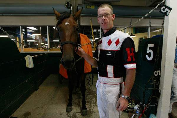 Driver-Mark-Headworth-stands-next-to-the-horse-M