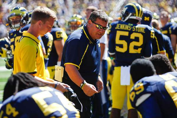 Michigan-Head-Coach-Brady-Hoke-talks-with-players