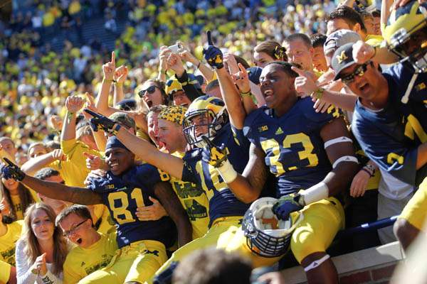 Michigan-players-and-student-celebrate-beating