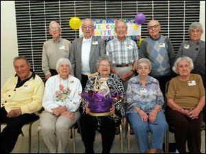 From the left, rear:  Arnold Skiver, of Holland; Stan Sekerka, of Saline; Norm Heydinger, of Toledo; Joe Starkey, of Walbridge; and Ruth Kornrumpf Watrol, of Maumee. Front row: Chris Zervos, of Toledo; Jean Baumgartner Murphy, of Oregon; Bernice Baker Langenderfer [with centerpiece], of Maumee; Gertrude Knierim, of Millbury; Anita Schlagel Lyzan, of Northwood.