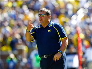 Michigan Head Coach Brady Hoke yells from the sidelines during the final minutes of the game.