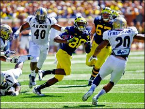 Michigan sophomore Jehu Chesson (86) runs the ball.