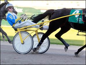 Tyler Rush crosses the finish line to win the first race of the night on