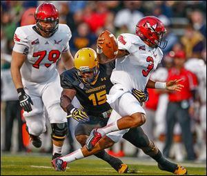 Toledo's Jayrone Elliott sacks Eastern Washington quarterback Vernon Adams in the first quarter.