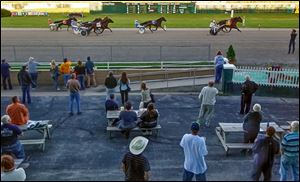 The crowd watches Saturday night at Raceway Park. The track has hosted horse racing since 1958, but the final 13 races will take place today beginning at 6 p.m.