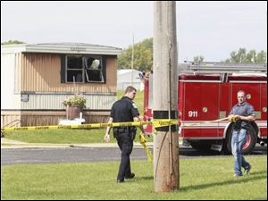 Authorities investigate the scene of a fire.