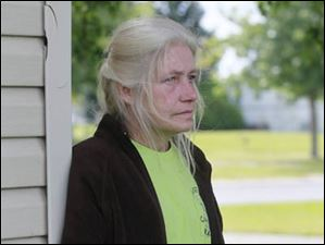 Neighbor Cheryl L. Opp said the was the most horrific scene she has ever witnessed. .