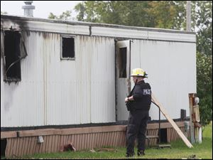 Wm. Timothy Spradlin, Chief of the Fire & Explosion Investigation Bureau with the Division of the State Fire Marshal, investigates the scene.