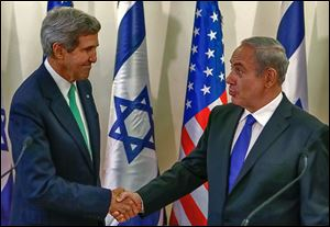 John Kerry, left, shakes hands with Israel's Prime Minister Benjamin Netanyahu Sunday in Jerusalem after speak-ing to the press.