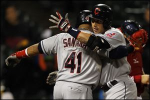 Cleveland's Asdrubal Cabrera, right, celebrates with teammate Carlos Santana after hitting a home run against the Chicago White Sox during the sixth inning today in Chicago. Santana also scored on Cabrera's home run.