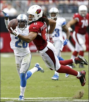 Arizona Cardinals wide receiver Larry Fitzgerald can't make the catch as Detroit Lions cornerback Bill Bentley defends during the second half today in Glendale, Ariz.