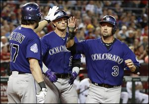 Colorado Rockies' Todd Helton (17) will retire at the end of the season after 17 years with the club.