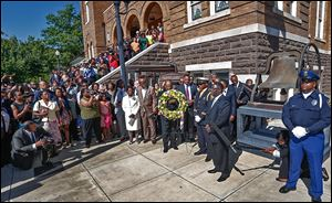 Churchgoers gather outside as a wreath is placed at 16th Street Baptist Church in Birmingham, Ala., on the 50th anniversary of the bombing that killed four young girls and galvanized the civil rights movement. Hundreds attended Sunday's commemoration event and said the work to ensure racial equality is unfinished.